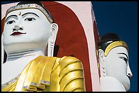 Detail of two of the four seated buddhas in  Kyaik Pun Paya. Bago, Myanmar ( color)