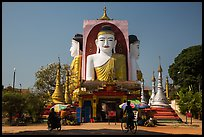 Four buddhas sitting back to back to four directions, Kyaik Pun Pagoda. Bago, Myanmar ( color)