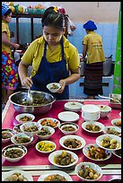Cooks serving Burmese food. Bago, Myanmar ( color)