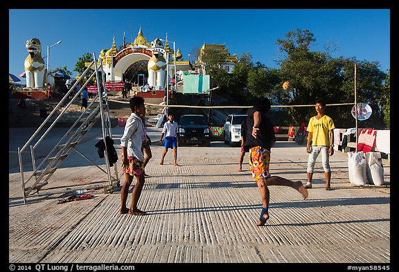 Young men play chin lone (kick volleyball) at Yatetaung. Kyaiktiyo, Myanmar (color)