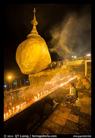 Offerings to the Buddha continues throughout the night at the Golden Rock. Kyaiktiyo, Myanmar (color)