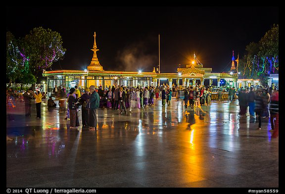 Crowds on main plaza at night. Kyaiktiyo, Myanmar (color)