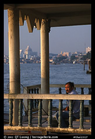 Man fishing on the Chao Phraya river. Bangkok, Thailand