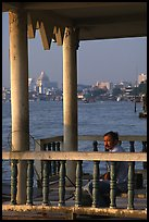 Man fishing on the Chao Phraya river. Bangkok, Thailand (color)