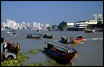 Chao Phraya river crowded with boats. Bangkok, Thailand