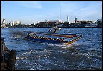 Crowded long tail taxi boat on Chao Phraya river. Bangkok, Thailand
