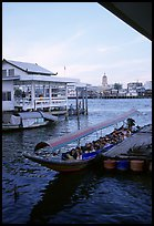 Evening commute, long tail taxi boat on Chao Phraya river. Bangkok, Thailand