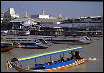 Flotilla of boats on the Chao Phraya river. Bangkok, Thailand