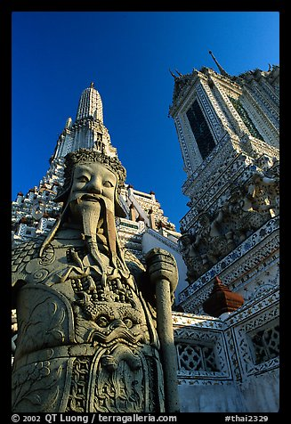 Statue and tower, Wat Arun. Bangkok, Thailand (color)