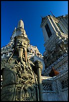 Statue and tower, Wat Arun. Bangkok, Thailand