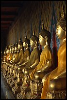Row of Buddha statues in gallery, Wat Arun. Bangkok, Thailand