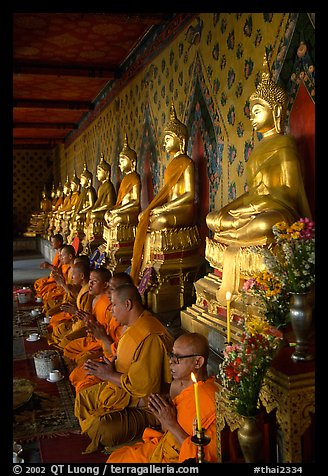 Buddhist monks and buddha statues, Wat Arun. Bangkok, Thailand