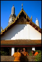Monks outside Wat Arun. Bangkok, Thailand
