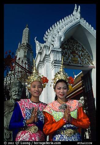 Girls in traditional thai costume, Wat Arun. Bangkok, Thailand