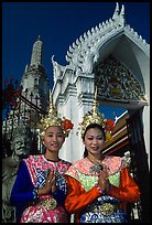 Girls in traditional thai costume, Wat Arun. Bangkok, Thailand (color)