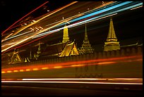 Wat Phra Kaew seen through the lights of traffic. Bangkok, Thailand