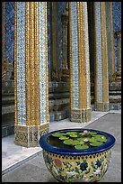 Lotus flowers and ornemented colunm, Wat Phra Kaew. Bangkok, Thailand