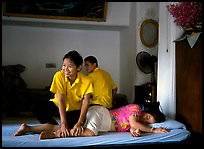 Traditional thai massage in traditional Thai medicine center of Wat Pho. Bangkok, Thailand ( color)