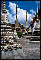 Layered and streamlined chedis in Ratanakosin style, Wat Pho. Bangkok, Thailand (color)