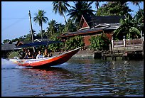 Fast boat along khlong on Thonbury canals. Bangkok, Thailand