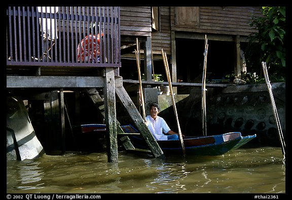 Conversation with neighbor along Thonbury canal. Bangkok, Thailand (color)