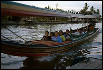 Evening commute, long tail taxi boat on canal. Bangkok, Thailand (color)