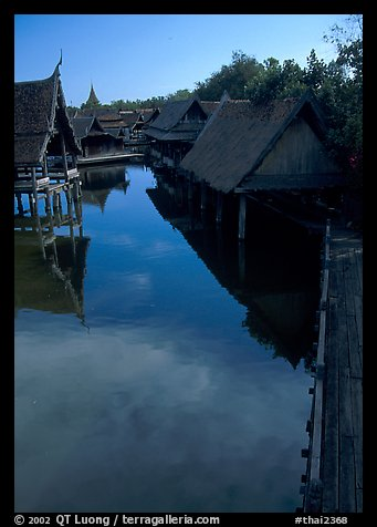 Village along canal. Muang Boran, Thailand (color)