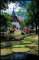 Lotus pond and Ayuthaya-style temple. Muang Boran, Thailand