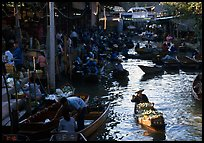 Woman paddling, floating market. Damonoen Saduak, Thailand ( color)
