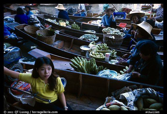 Woman on small boat, floating market. Damonoen Saduak, Thailand (color)