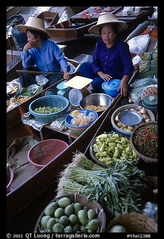 Women selling fruits and vegetables, Floating market. Damonoen Saduak, Thailand