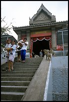 San Phra Kan (Kala shrine), invaded by monkeys. Lopburi, Thailand (color)