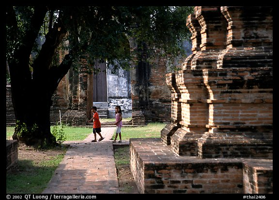 Children walk among ruins of the King Narai's palace. Lopburi, Thailand