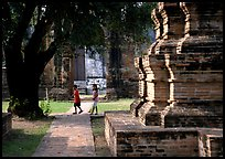 Children walk among ruins of the King Narai's palace. Lopburi, Thailand ( color)