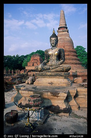 Classic sitting Buddha image and tiered, bell-shaped chedi. Sukothai, Thailand (color)