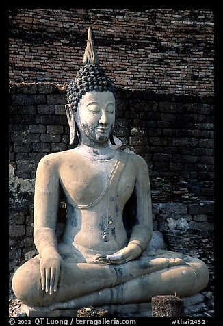 Classic sitting Buddha image, with boneless style typical of period. Sukothai, Thailand (color)