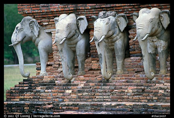 Some of the 36 elephants at the base of Wat Cahang Lom. Sukothai, Thailand (color)