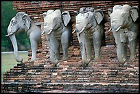 Some of the 36 elephants at the base of Wat Cahang Lom. Sukothai, Thailand ( color)