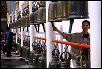 Worshiper rings bells at Wat Phra That Doi Suthep. Chiang Mai, Thailand ( color)