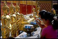 Worshiper makes offering at Wat Phra That Doi Suthep. Chiang Mai, Thailand