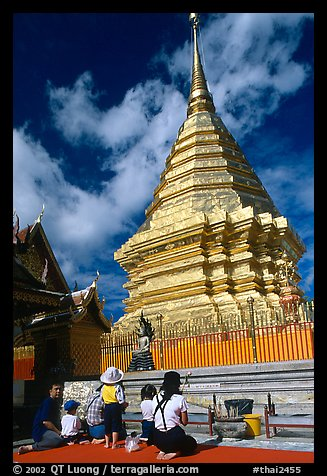 Worshipers at the Chedi of Wat Phra That Doi Suthep. Chiang Mai, Thailand (color)