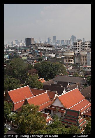 Temple rooftop and modern skyline. Bangkok, Thailand (color)