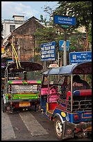 Tuk Tuks and signs. Bangkok, Thailand (color)