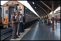 Train platform and attendants. Bangkok, Thailand (color)