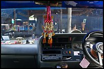 Bus dashboard with religious items. Thailand ( color)