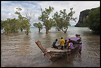 Boat boarding amongst mangroves, Ao Railay East. Krabi Province, Thailand