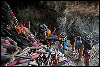 Locals worship at Pranang Cave, Railay. Krabi Province, Thailand