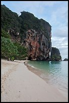 Pranang Cave Beach and limestone crag, Railay. Krabi Province, Thailand (color)