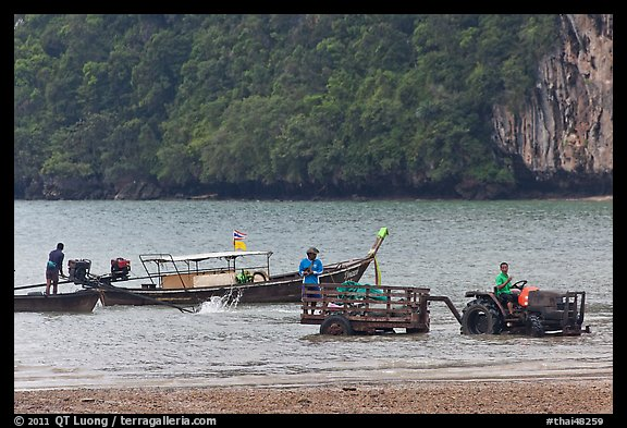 Tractor and longtail boat,  Railay East. Krabi Province, Thailand (color)