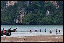 Disembarking at low tide, Rai Leh East. Krabi Province, Thailand